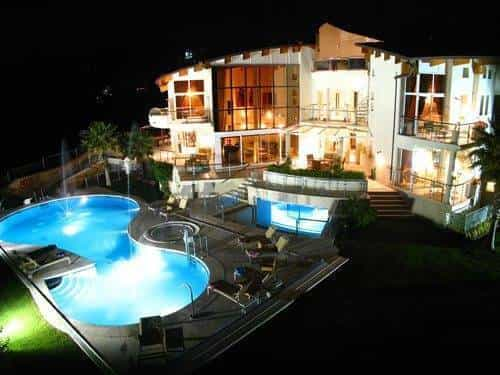 Stunning night shot of villa and pool