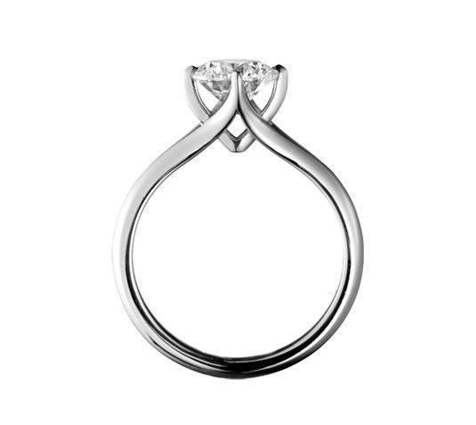 Coronet platinum with princess cut diamond, Simon Pure £1,050