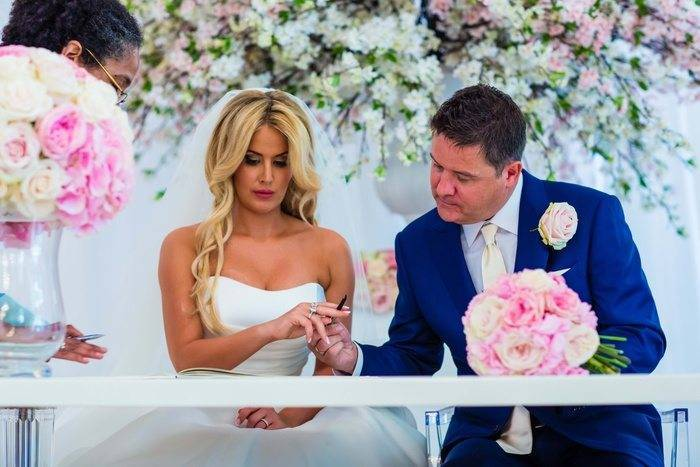 Bride and Groom Signing At Wedding