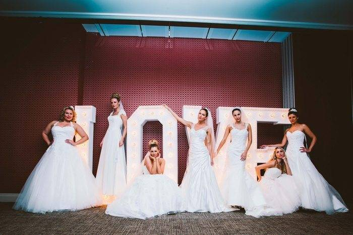 Brides with Love Sign From Amanda Wyatt