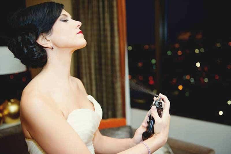 Bride Putting Perfume On