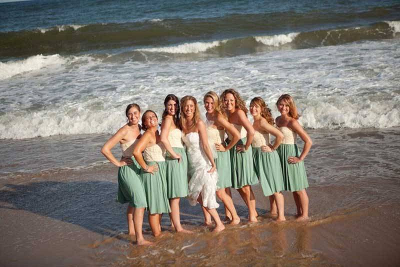 Bride With Bridesmaids On Beach