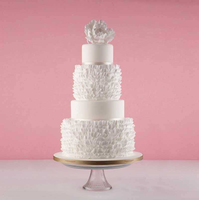 Ruffle Cake - Inspired by garters and petticoats and topped with sugar flowers.