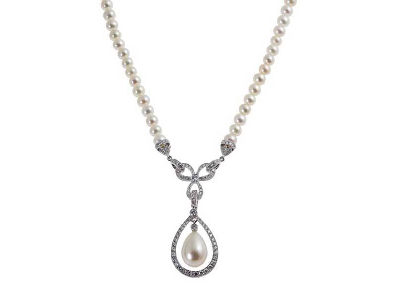 Diamond and Pearl Bow Pendant