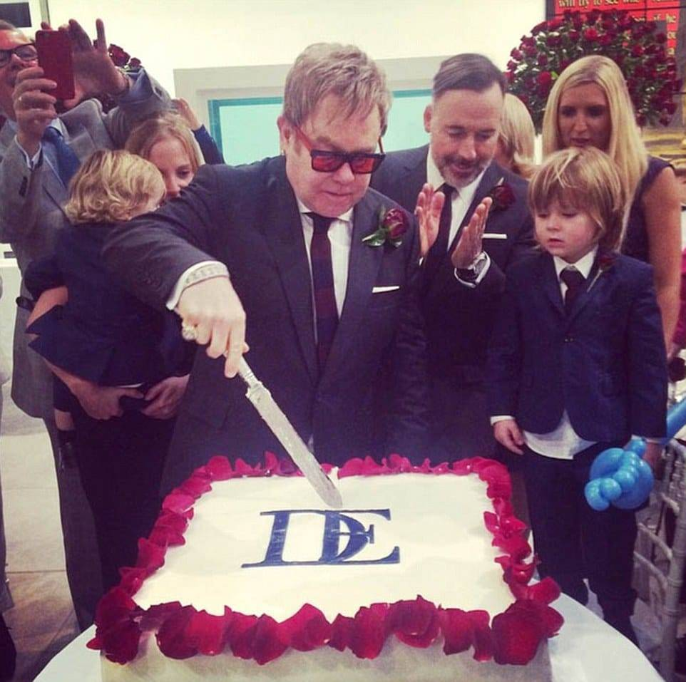 Sir Elton John Cutting His Wedding Cake