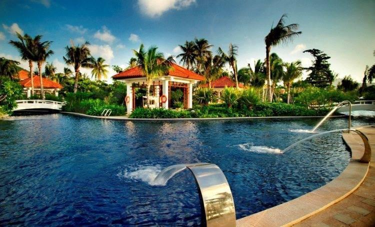 China s hainan island a luxury wedding destination for Garden pool wedding