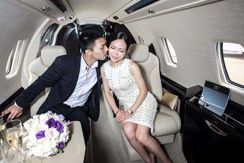 Couple Kissing In Private Jet