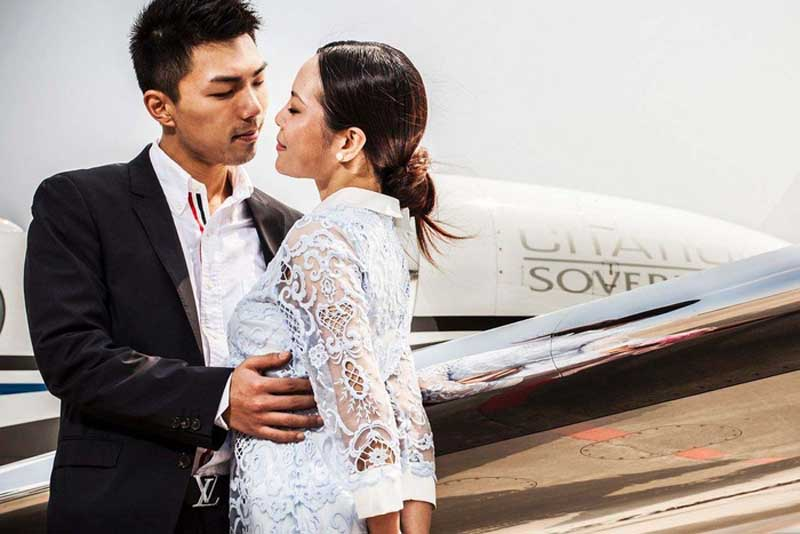 Bride and Groom Kissing Outside Private Jet