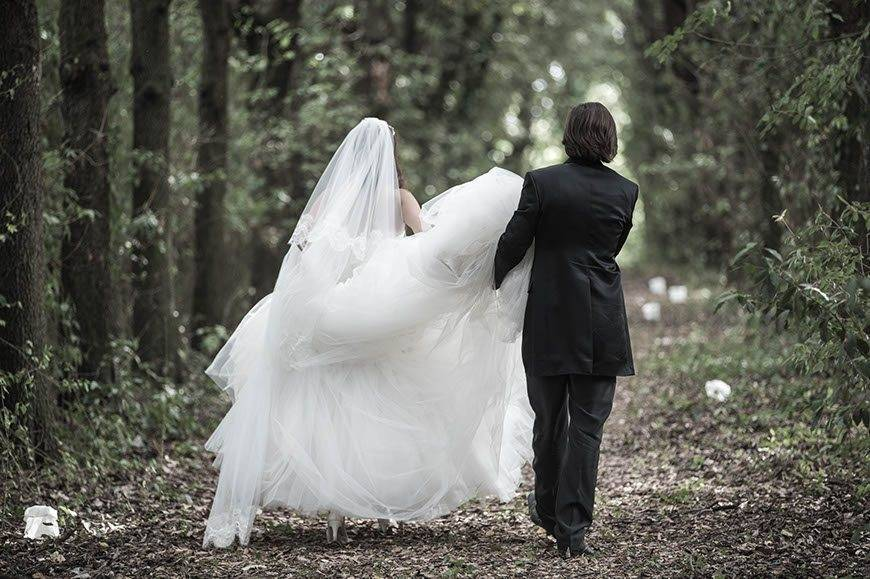 Wedding couple walking through the wood - Top 5 Wedding Venues In Romagna Italy