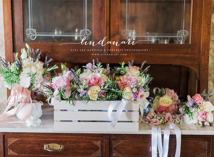 The prettiest of blooms. Gorgeous summer coloured roses, peonies, lavender and rosemary accent the hand tied bridal bouquet and bridesmaid's posies.