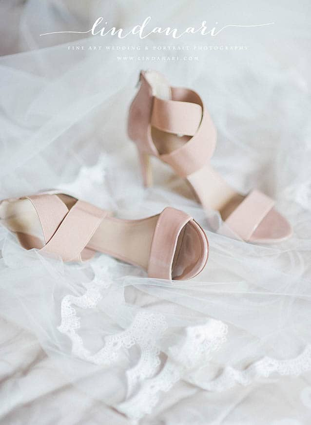 Pretty in pink. The shoes nestle in the whispering lace veil