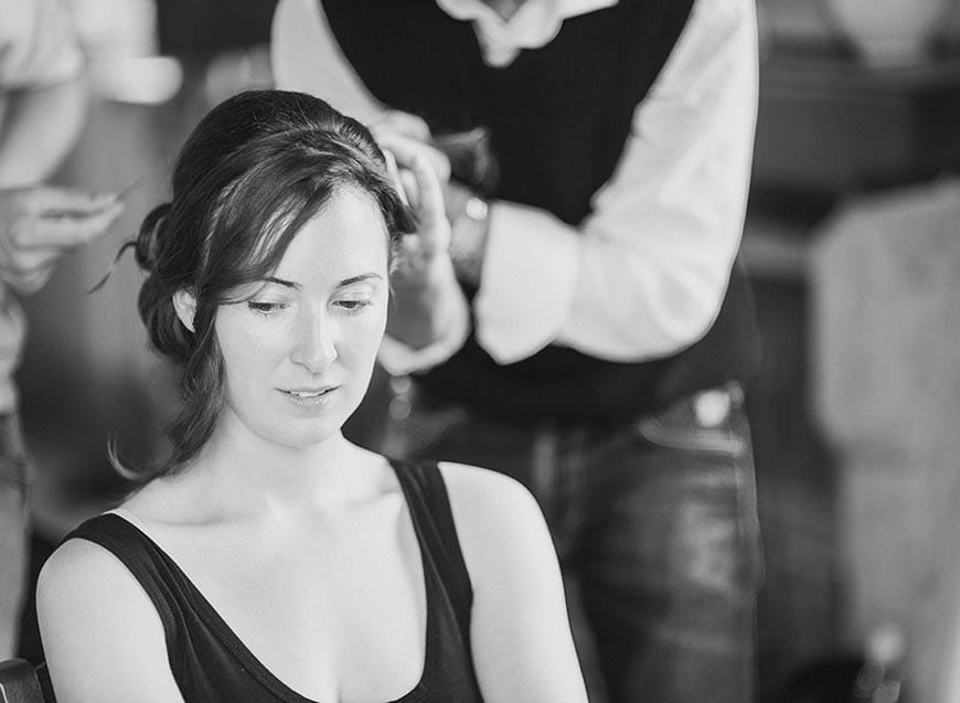 The bride prepares! Jodi's hair is held up in a loose chignon at the side
