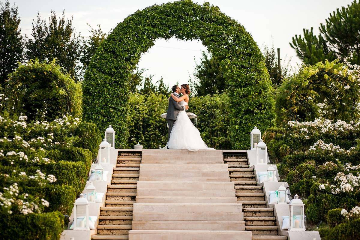Bride and Groom on scenic staircase - Luxury Wedding Gallery