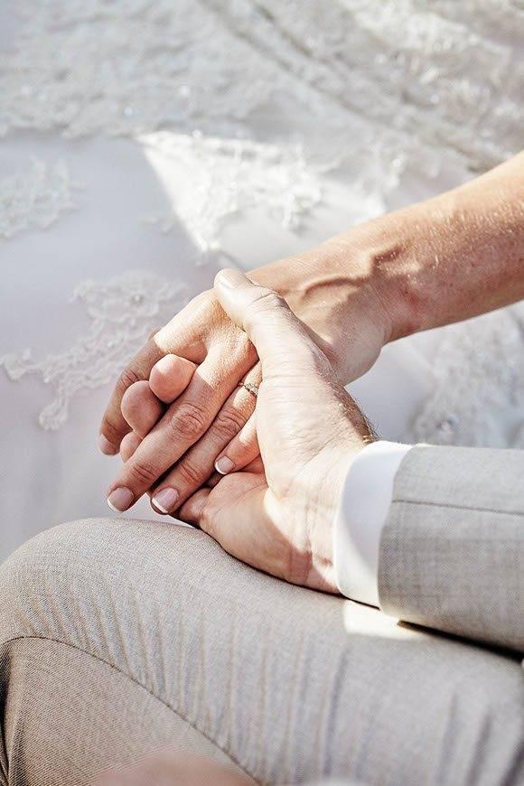 Dream Weddings Mykonos holding hands - Luxury Wedding Gallery