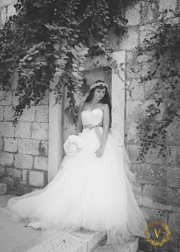 Martina-wearing-gorgeous-Vera-Wang-wedding-dress-for-her-wedding-in-Hvar