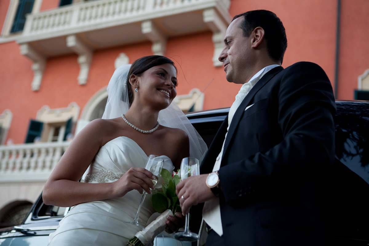 Wedding couple in fron of the villa - Luxury Wedding Gallery