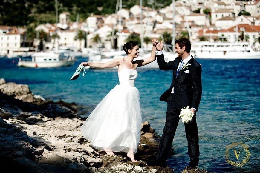 enjoying photoshoot on the rocks in Hvar - Luxury Wedding Gallery