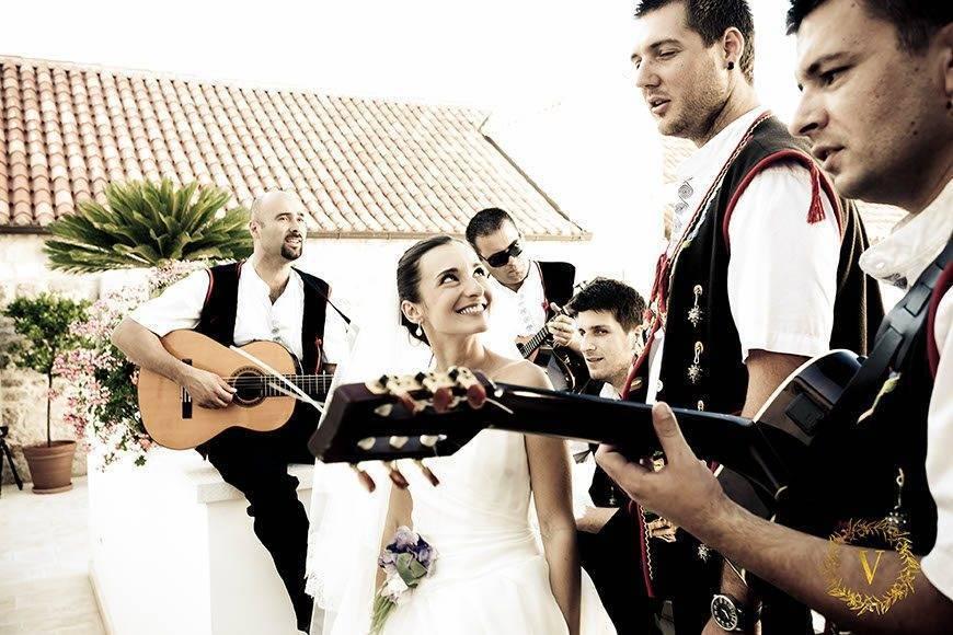 traditional dalmatian singers serenading the bride - Luxury Wedding Gallery