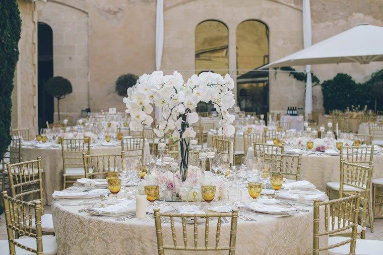 Neutral table decor at Cap Rocat by Alago Events - Luxury Wedding Gallery