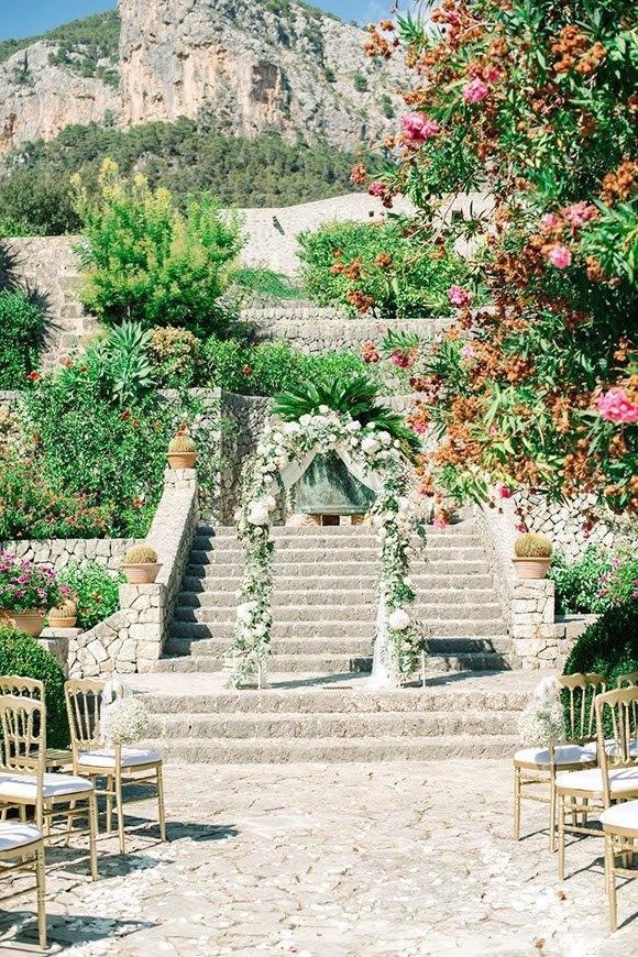 Stunning ceremony back drop with flower arch by Alago Events - Luxury Wedding Gallery