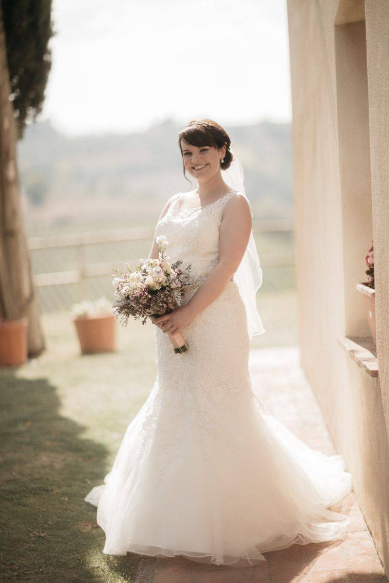The blushing bride in her gorgeous gown