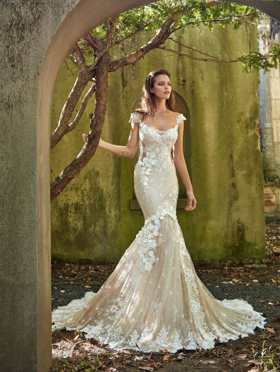 Emma - Such pretty floral detailing, with a mermaid style skirt and elegant neckline that is so flattering