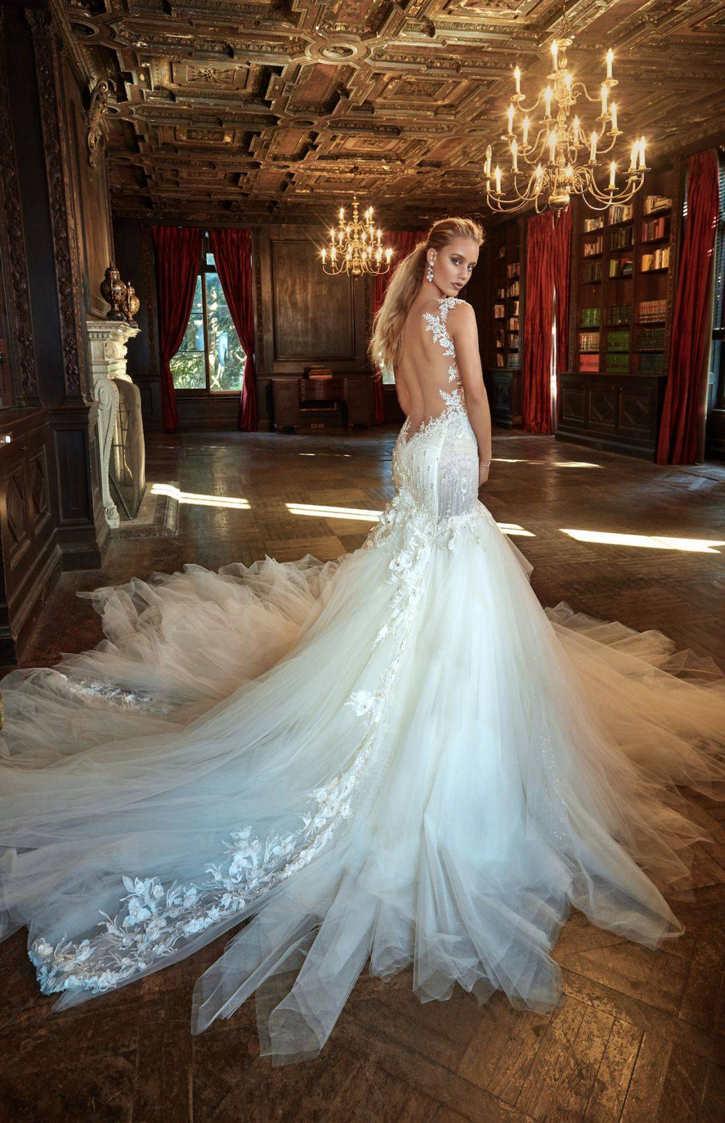 Suzanne - Abundant layers of fluffy tulle in a mermaid skirt with pretty detailing and a gorgeous dropped back