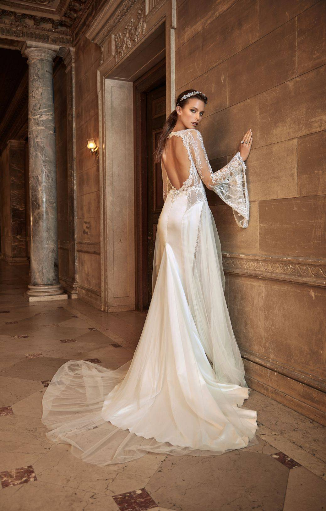 Penelope - A simple train and a gorgeous cut out back draw focus to the elegant lace sleeves