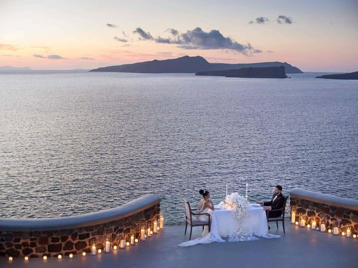 001.OPENING PHOTO JOHN NASSARI MITHEO EVENTS SANTORINI BLESSING - Luxury Wedding Gallery