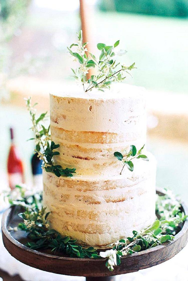 Combine a classic white wedding cake with hints of greenery