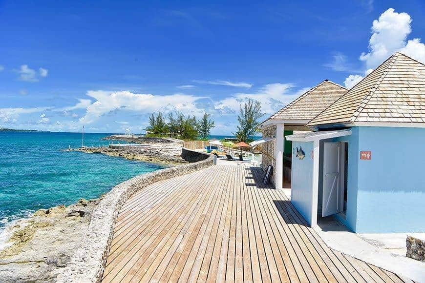 Pearl Island Bahamas patio blue bar ocean view - Luxury Wedding Gallery