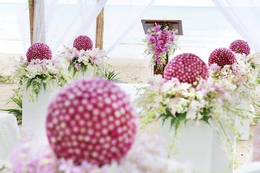 Pearl Island Bahamas wedding ceremony location flowers seating area - Luxury Wedding Gallery