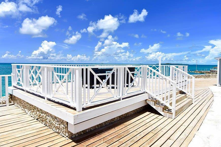 Pearl Island Bahamas wedding ceremony location ocean view terrace - Luxury Wedding Gallery