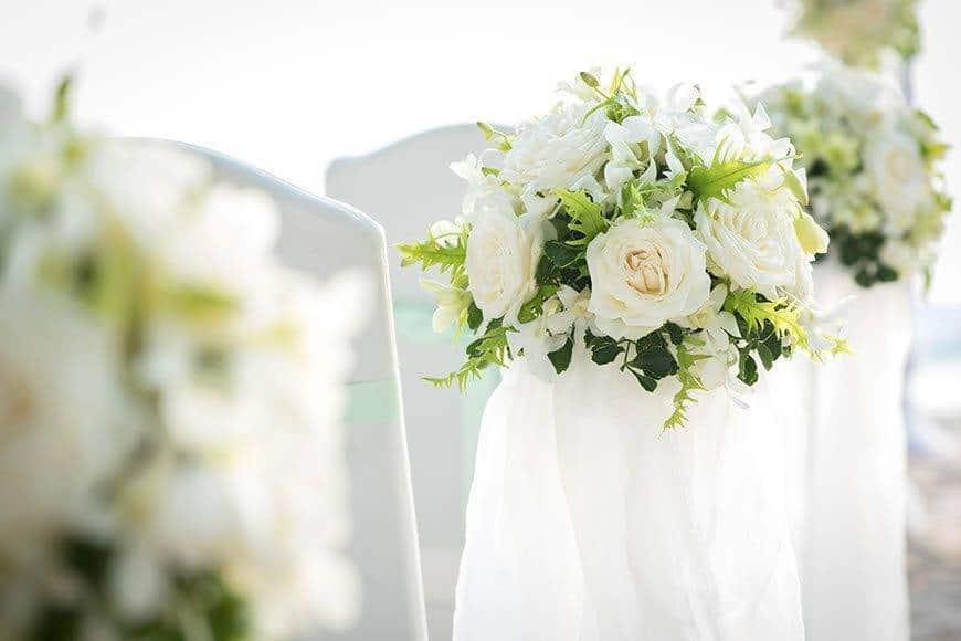 Pearl Island Bahamas wedding seating flowers beach - Luxury Wedding Gallery