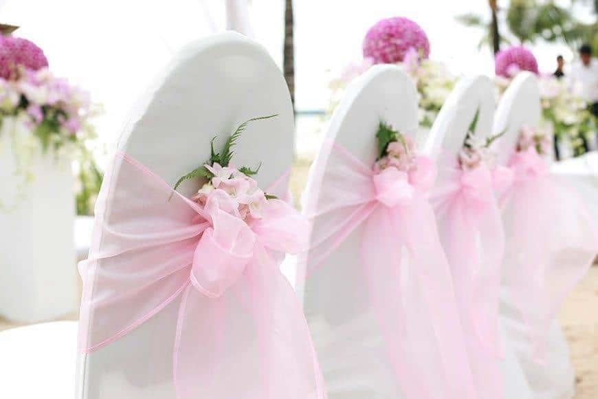 Pearl Island Bahamas wedding seating flowers - Luxury Wedding Gallery