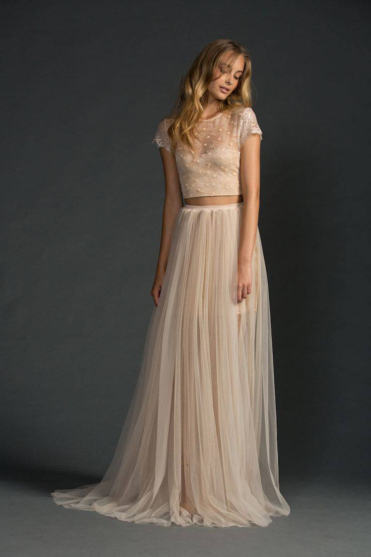 A soft blush dress is such a pretty choice, with layers of tulle for extra texture