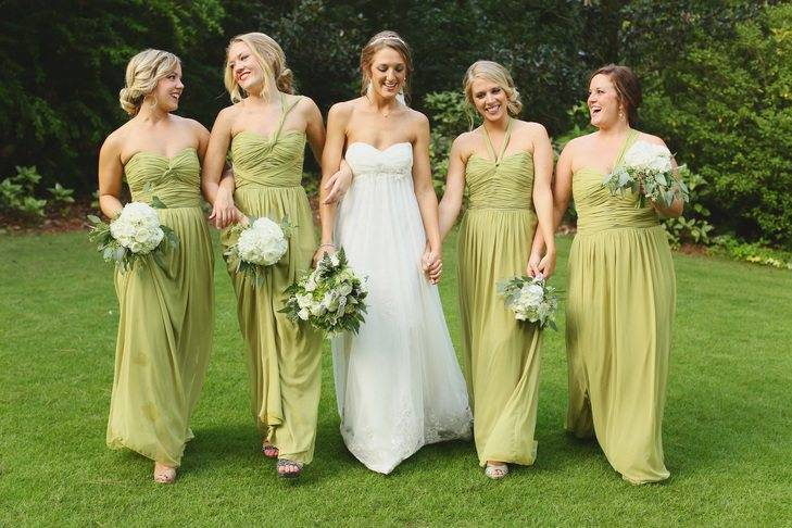 Choose a muted green for your bridesmaids and coordinate your dress with white flowers and plenty of foliage!