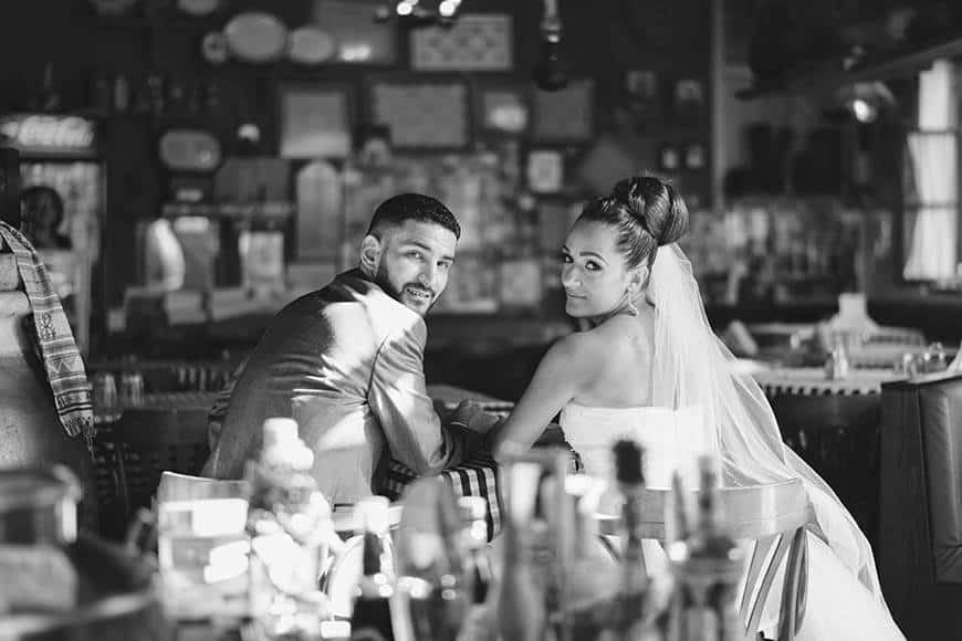 Bride and groom in a cyprus traditional tavern - Luxury Wedding Gallery
