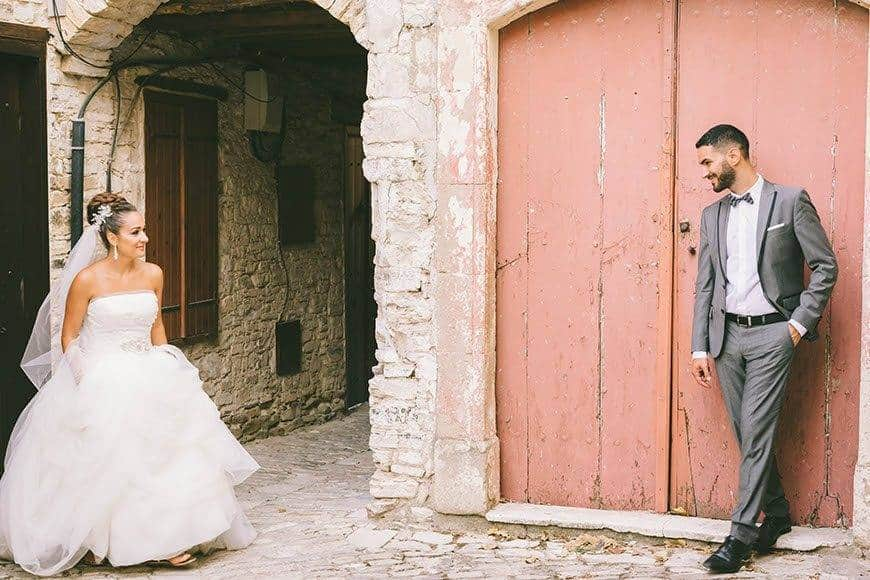 Bride and groom meeting in an alley of a cyprus traditional village - Luxury Wedding Gallery