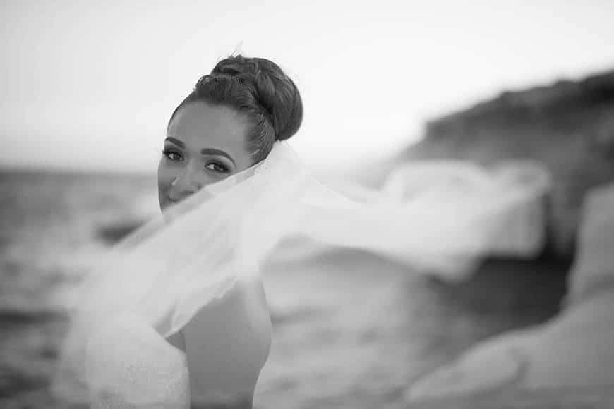 Bride with wedding veil on the beach in Cyprus - Luxury Wedding Gallery