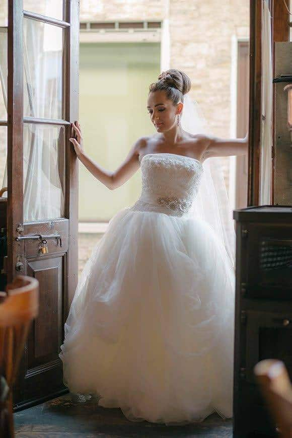 Cypriot bride standing in the doorways of a traditional cypriot tavern - Luxury Wedding Gallery