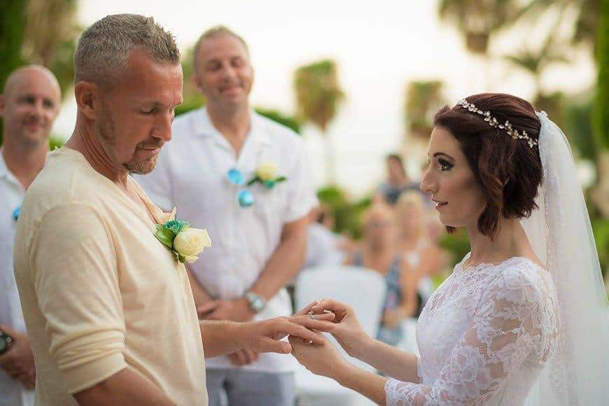 Exchanging rings between bride and groom on beach in Cyprus - Luxury Wedding Gallery