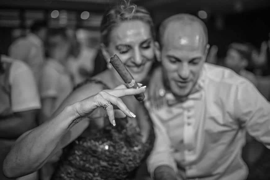 Mother in law dancing with Cohiba cigar at a cyprus wedding - Luxury Wedding Gallery