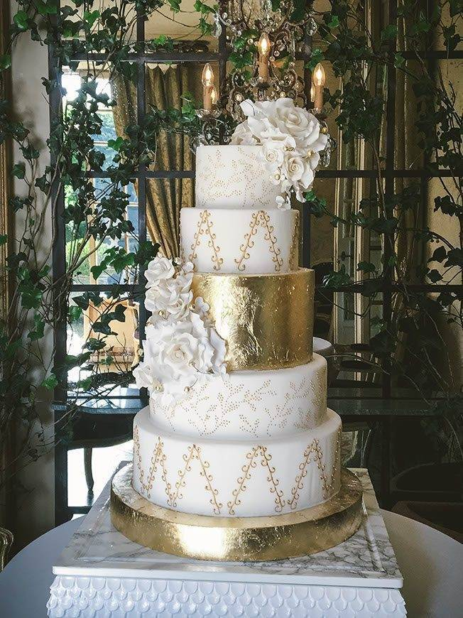 borgo santo pietro 5 star resort tuscan wedding cakes gold leaf sugar flower tiered cake - Luxury Wedding Gallery