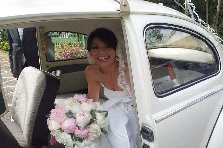 Bride in vintage car - Luxury Wedding Gallery