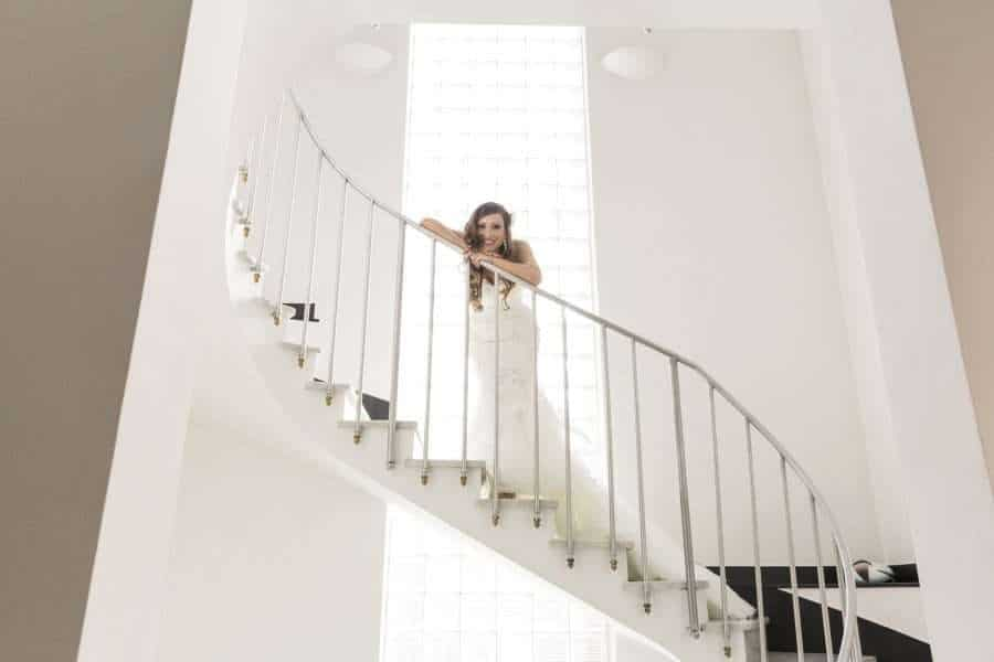 Outdoors Indoors wedding - bride on steps
