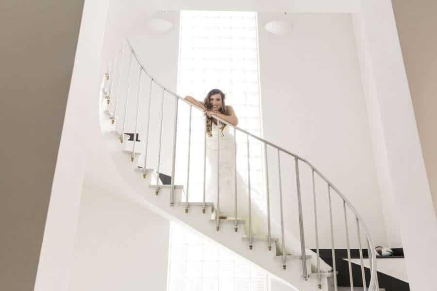 Outdoors Indoors wedding - bride on steps