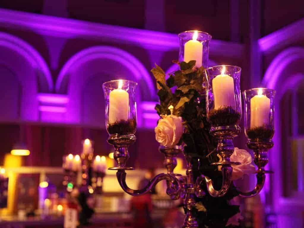 17 Wallace Collection Courtyard candle table centre detail photocredit cCharlotte Fielding - Luxury Wedding Gallery