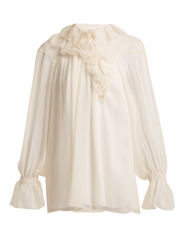 Asymmetric ruffle-trimmed silk blouse