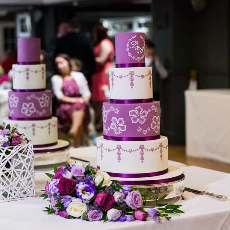 PURPLE AND IVORY WEDDING CAKES